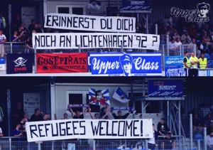 Fans of Goslar remember the victims of an attack on a refugees home in the 90s.