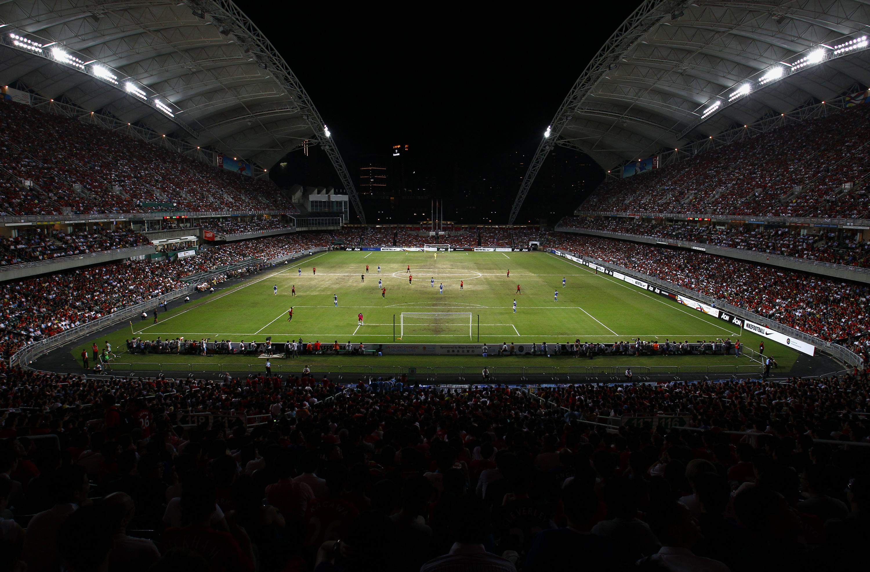 Manchester United and Kitchee play on partly sandy ground during their friendly match in Hong Kong