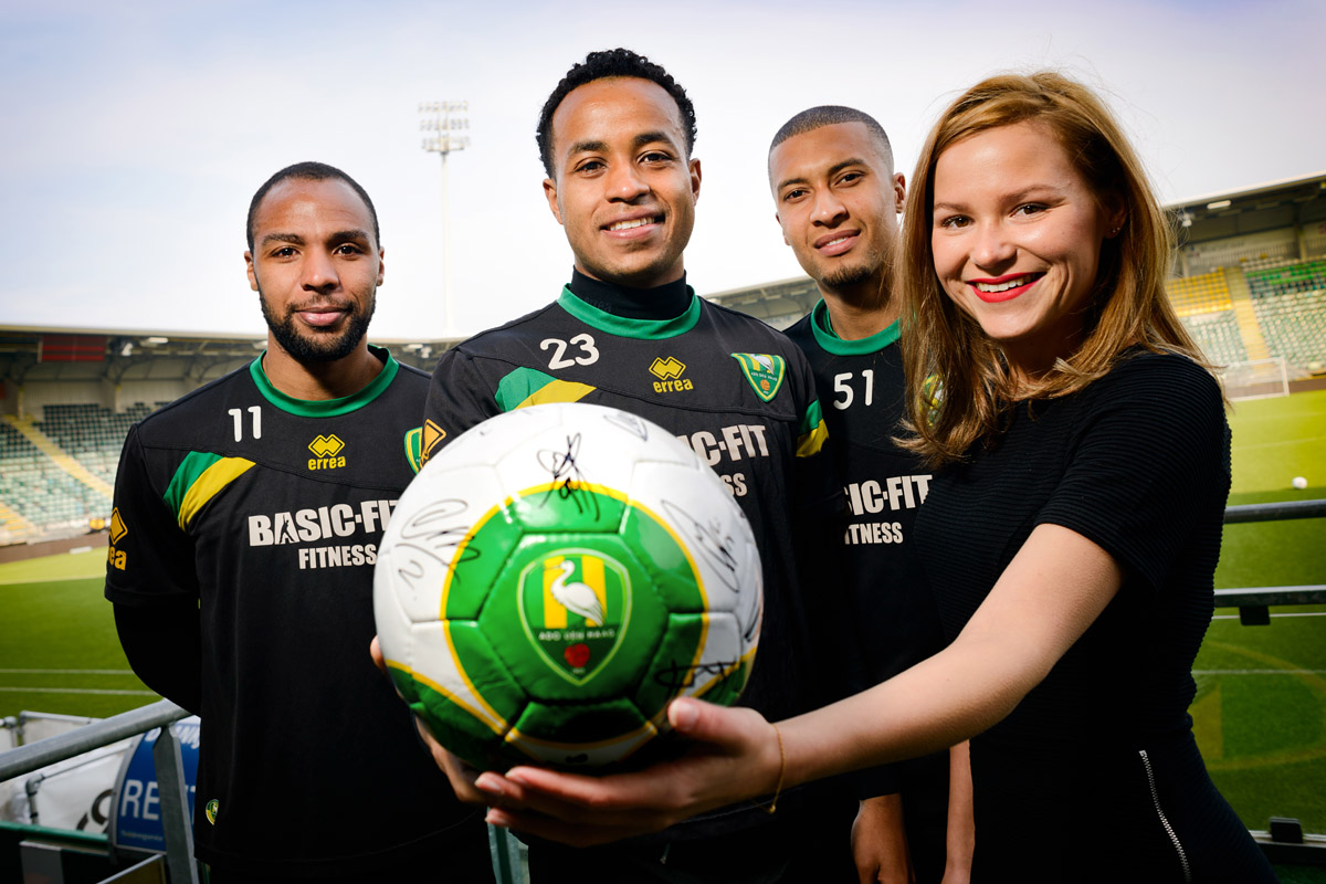 Players of ADO Den Haag with autographed football