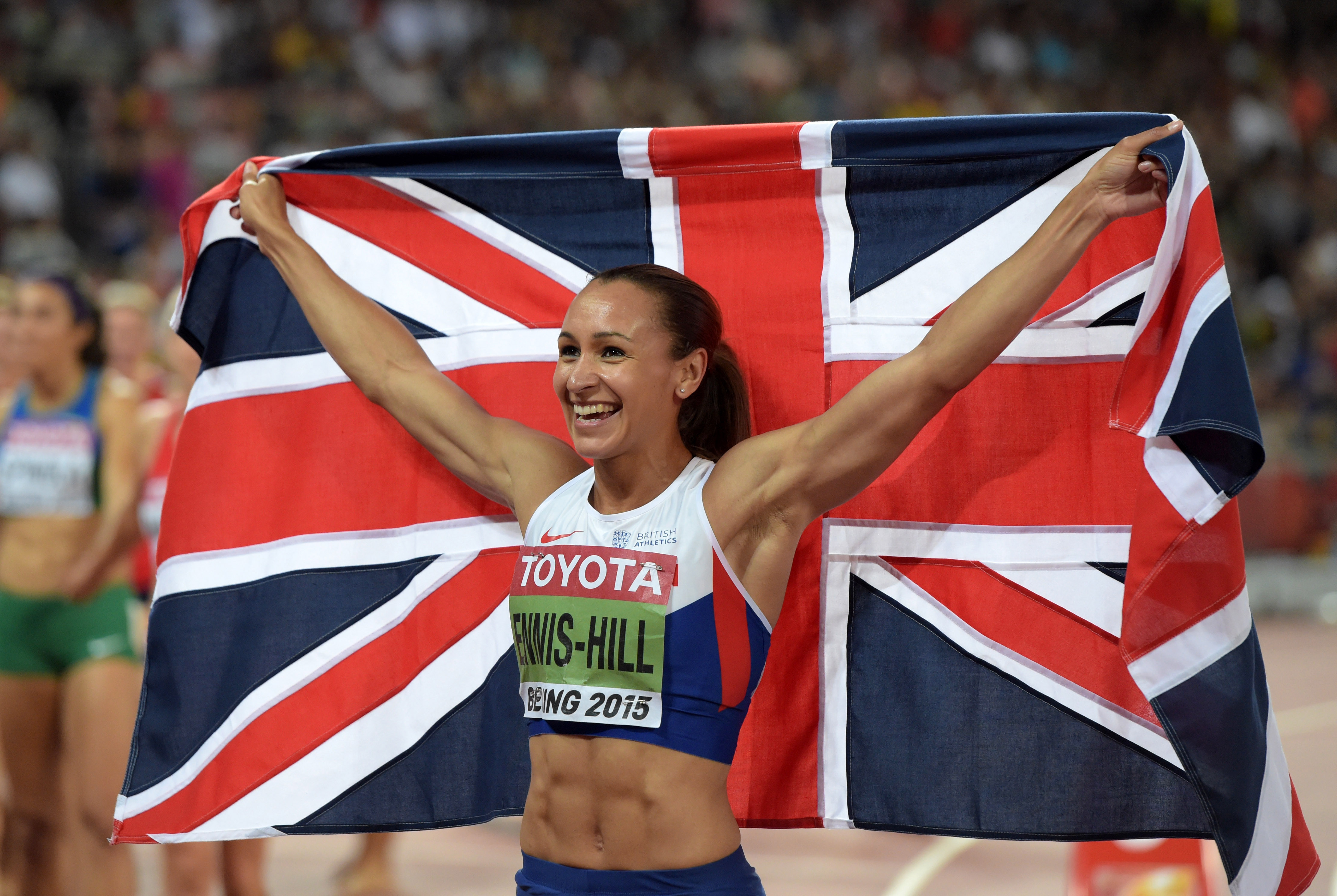 Aug 23, 2015; Beijing, China; Jessica Ennis-Hill (GBR) poses with British flag after winning the heptathlon with 6,669 points during the IAAF World Championships in Athletics at National Stadium. Mandatory Credit: Kirby Lee-USA TODAY Sports / Reuters Picture Supplied by Action Images *** Local Caption *** 2015-08-23T161551Z_551337508_NOCID_RTRMADP_3_TRACK-AND-FIELD-IAAF-WORLD-CHAMPIONSHIPS-IN-ATHLETICS-EVENING-SESSION.JPG