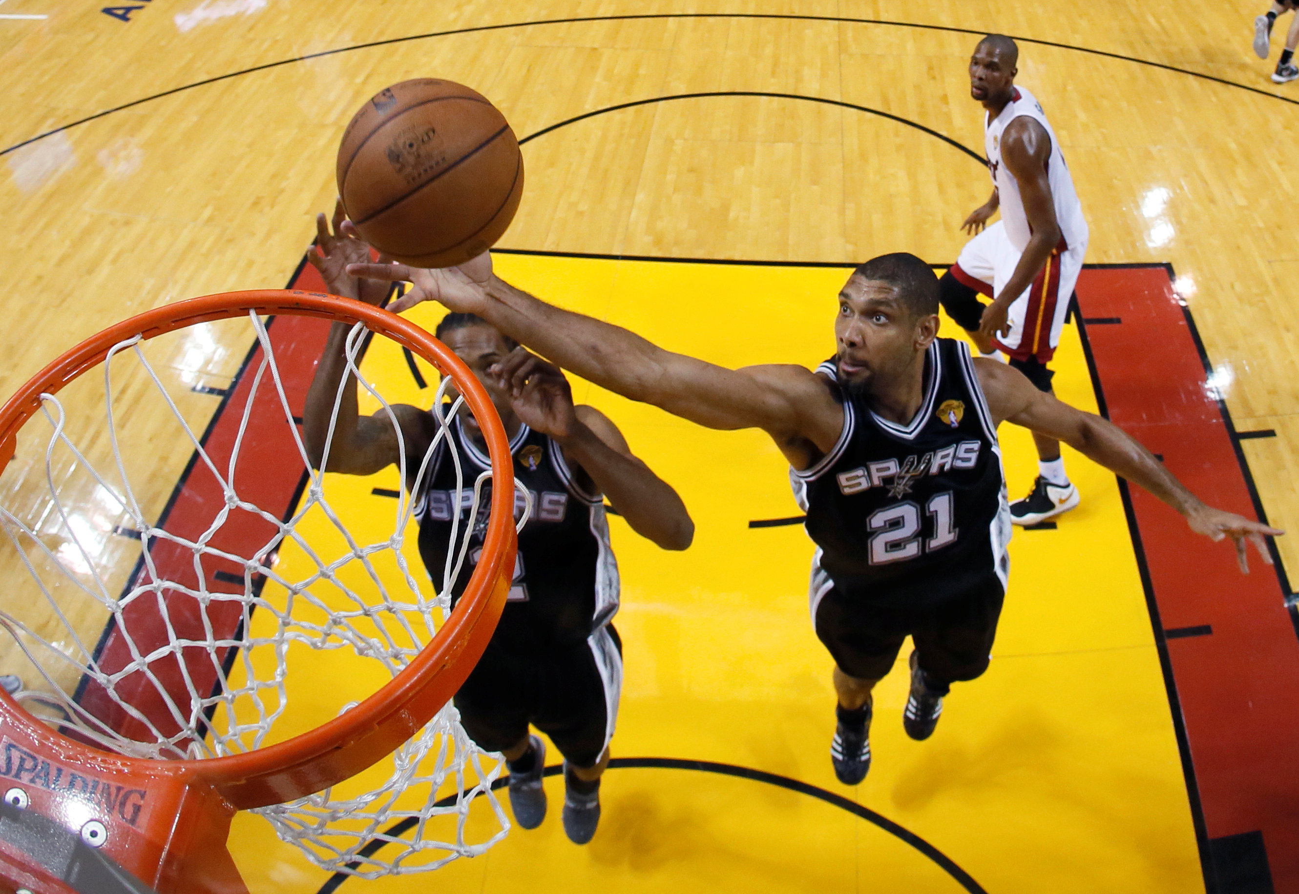 San Antonio Spurs power forward Tim Duncan (21) pulls down a rebound against the Miami Heat during Game 6 of their NBA Finals basketball playoff in Miami, Florida June 18, 2013. REUTERS/Kevin C. Cox/Pool/File Photo Picture Supplied by Action Images