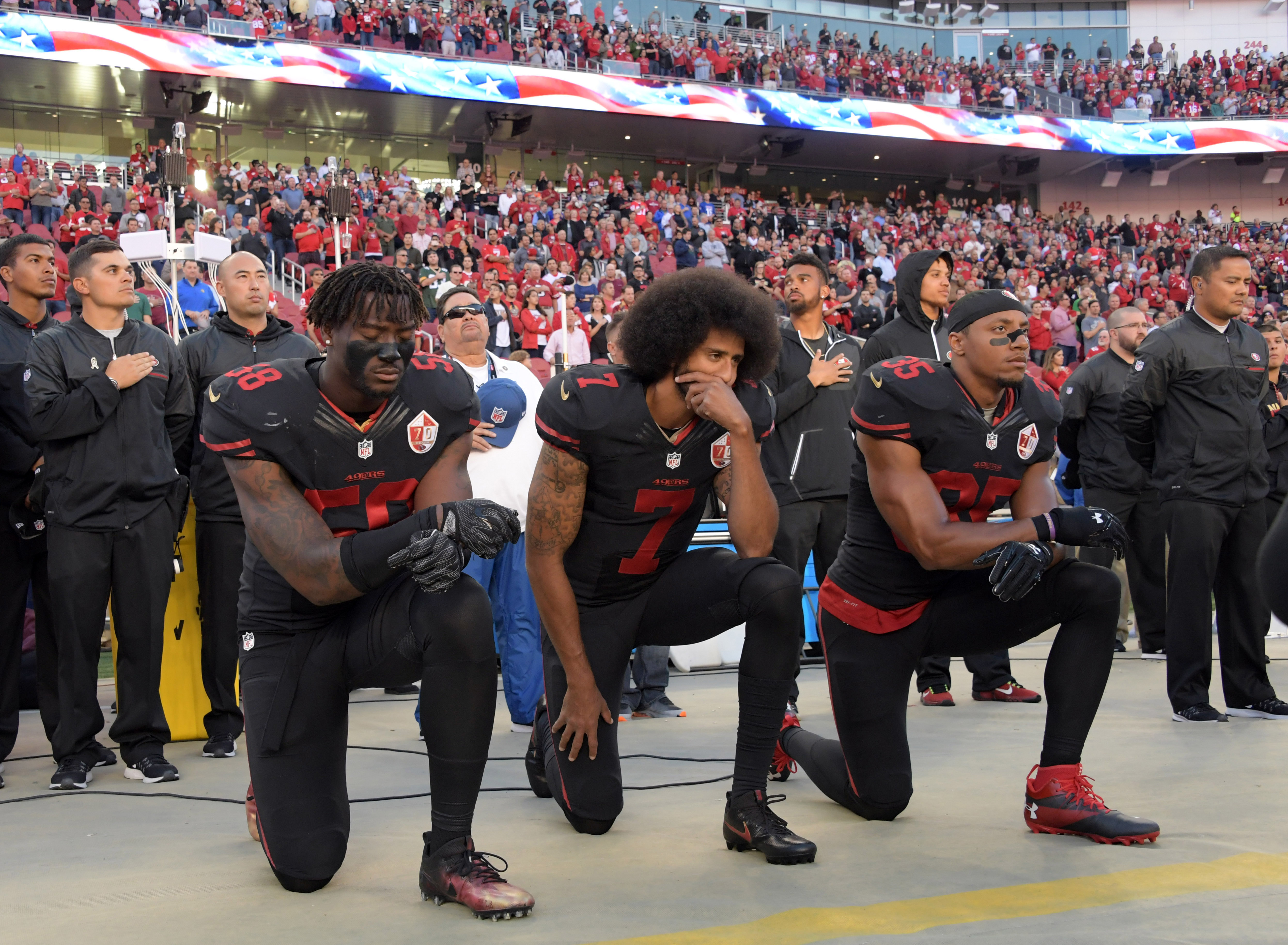 Oct 6, 2016; Santa Clara, CA, USA; San Francisco 49ers outside linebacker Eli Harold (58), quarterback Colin Kaepernick (7) and free safety Eric Reid (35) kneel in protest during the playing of the national anthem before a NFL game against the Arizona Cardinals at Levi's Stadium. Mandatory Credit: Kirby Lee-USA TODAY Sports / Reuters Picture Supplied by Action Images (TAGS: Sport American Football NFL) *** Local Caption *** 2016-10-07T004015Z_262046146_NOCID_RTRMADP_3_NFL-ARIZONA-CARDINALS-AT-SAN-FRANCISCO-49ERS.JPG